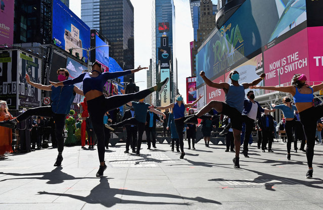 """Performers participate in """"We Will Be Back"""", a live pop-up event and commemoration of Broadway's 'lost year' at Time Square on March 12, 2021 in New York City. The theater community reunited exactly one year since Broadway shutdown due to the covid-19 pandemic. (Photo by Angela Weiss/AFP Photo)"""