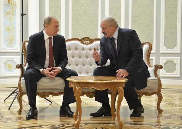 Belarus' President Alexander Lukashenko (R) meets with his Russian counterpart Vladimir Putin during peace talks in Minsk, February 11, 2015. (Photo by Alexei Druzhinin/Reuters/RIA Novosti/Kremlin)