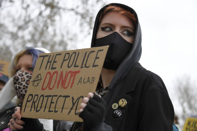 """A demonstrator holds a poster during a """"Kill the Bill"""" protest at Hyde Park in London, Saturday, April 3, 2021. (Photo by Alberto Pezzali/AP Photo)"""