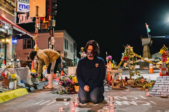 Courtney Ross, girlfriend of George Floyd, lays candles in the intersection of 38th St. & Chicago Ave on March 29, 2021 in Minneapolis, Minnesota. Opening statements begin today in the trial of former Minneapolis police officer Derek Chauvin who faces a second-degree murder charge in the death of George Floyd. (Photo by Brandon Bell/Getty Images)
