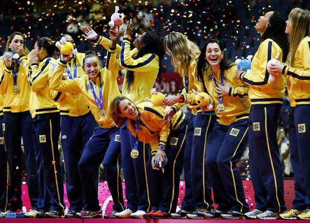 Brazil's players celebrate with the gold medal during the awards ceremony of the World Grand Prix Finals volleyball tournament in Sapporo, Japan, on September 1, 2013. (Photo by Koji Sasahara/Associated Press)