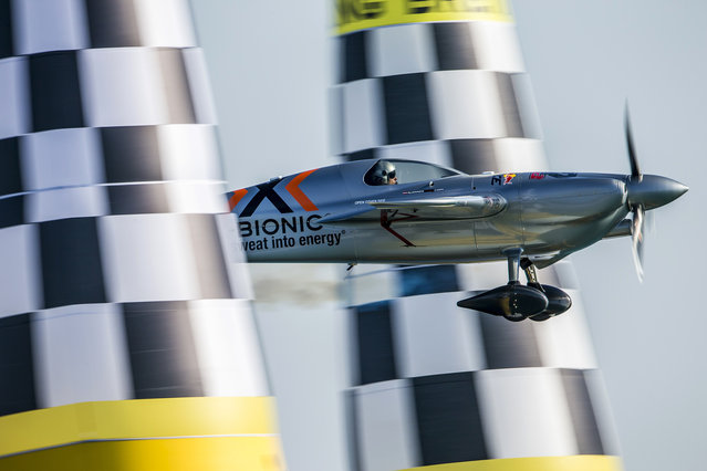 In this photo provided by Andreas Langreiter via Global-Newsroom, Hannes Arch of Austria performs during the finals of the first stage of the Red Bull Air Race World Championship in Abu Dhabi, United Arab Emirates, Saturday, February 14, 2015. (Photo by Andreas Langreiter/AP Photo/Global-Newsroom)