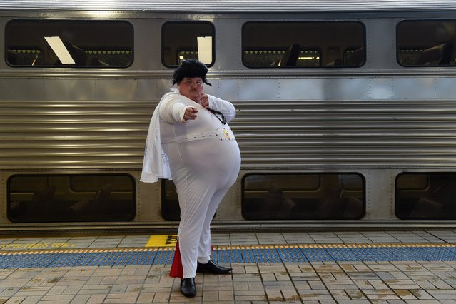 Elvis fan and impersonator Sean Wright of Bowral poses for a photograph before boarding the Elvis Express at Central Station in Sydney, Australia, 07 January 2016. The Elvis Express is bound for the Parkes Elvis Festival in the regional town of Parkes. (Photo by Dean Lewins/EPA)
