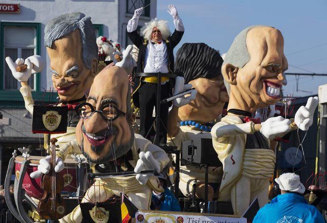 Giant figures depicting Belgian Prime Minister Charles Michel (C) and other politicians are seen during the 87th carnival parade of Aalst February 15, 2015. (Photo by Yves Herman/Reuters)