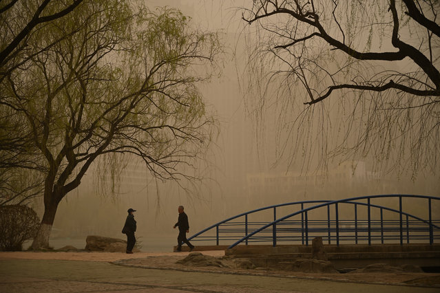 People visit a park as sandstorm hits the city on April 15, 2021 in Hohhot, Inner Mongolia Autonomous Region of China. (Photo by Liu Wenhua/China News Service via Getty Images)
