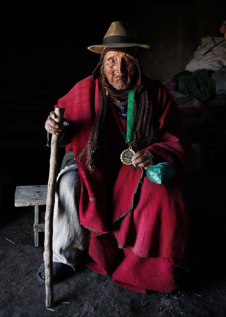 Carmelo Flores, a native Aymara, holds his medal, recently given to him by the governor of La Paz, as he poses for a photo inside his home in the village of Frasquia, Bolivia, on September 16, 2013. The La Paz governor awarded the medal to Flores, recognizing him as the oldest person on the planet. If Bolivia's public records are correct, Flores is the oldest living person ever documented. They say he turned 123 in July. (Photo by Juan Karita/Associated Press)