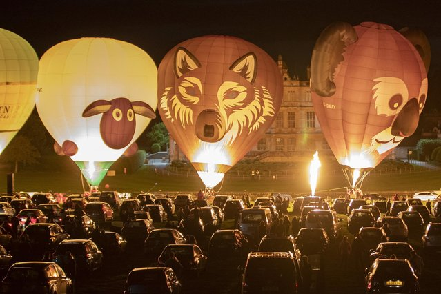 The Sky Safari hot-air balloon festival taking place at Longleat stately home in Wiltshire, UK on Friday,  September 11, 2020. Spectators had to watch from their cars to meet social-distancing rules as the balloons took to the skies. (Photo by Corin Messer/BNPS)