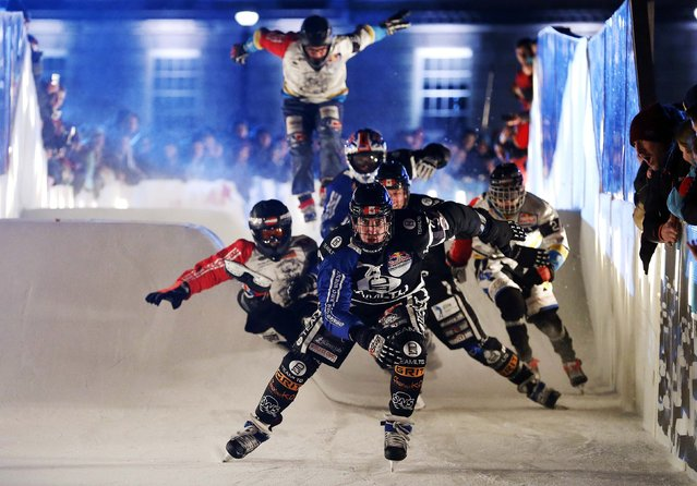 Scott Croxall of Team LTD leads the pack down the track at the Ice Cross Downhill World Championship race at the Stormont estate in Belfast February 20, 2015. (Photo by Cathal McNaughton/Reuters)