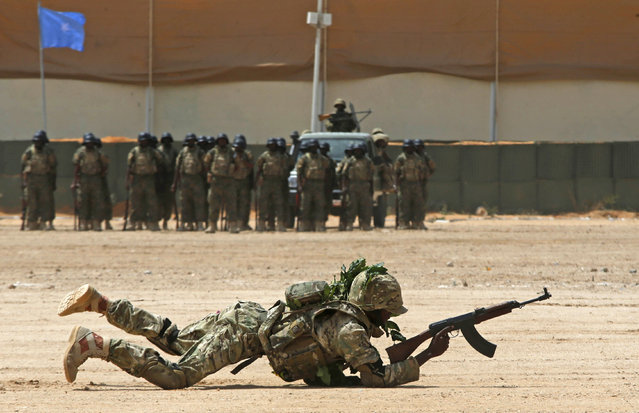 A member of the Somali military performs a defensive drill after attending a commando training exercise at the United Arab Emirates military training camp in the capital Mogadishu, Somalia January 20, 2016. (Photo by Feisal Omar/Reuters)