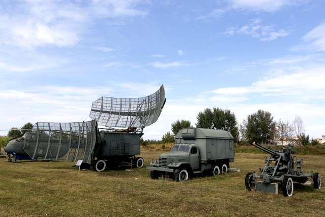 Old Albanian military vehicles are pictured at Kucova Air Base in Kucova, Albania on October 3, 2018. News of a NATO base has stirred hopes in Kucova. Civilians see the base project as an economic boost for an area plagued by emigration and unemployment. The last generation of trained pilots, now in their early fifties, are keen to hear the rumble of engines again, while younger people on the site mull quitting due to their low wages. (Photo by Florion Goga/Reuters)