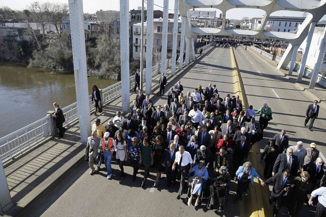 "U.S. President Barack Obama leads a march across the Edmund Pettus Bridge with first lady Michelle Obama, their daughters Malia and Sasha, members of Congress, former President George W. Bush and his wife Laura and civil rights leaders in Selma, Alabama March 7, 2015. The event commemorates the 50th anniversary of the ""Bloody Sunday"" march at the bridge, where police and state troopers beat and used tear gas against peaceful marchers who were advocating against racial discrimination at the voting booth.   REUTERS/Gerald Herbert/Pool  (UNITED STATES  - Tags: POLITICS ANNIVERSARY SOCIETY)"
