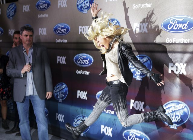 American Idol XIV finalist Jax jumps in the air during Fox's American Idol XIV Finalist Party at The District Restaurant in Los Angeles, California March 11, 2015. (Photo by Jonathan Alcorn/Reuters)