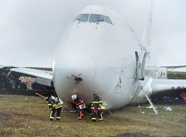 A SkyLease Cargo plane skidded off a runway at Halifax Stanfield International Airport and stopped near a road early on Wednesday, November 7, 2018. The airport activated its emergency operations centre and suspended all flights after the incident where the 747 cargo plane with five people on board went off the runway. (Photo by Canadian Press/Rex Features/Shutterstock)