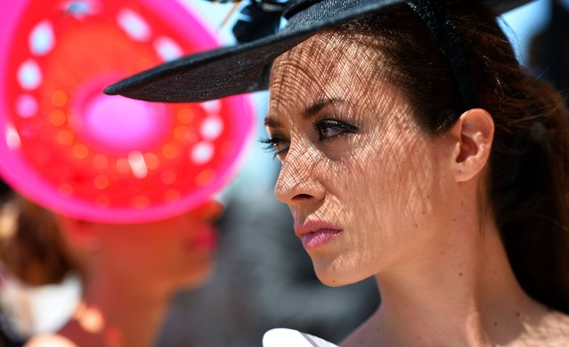 A race-goer models her outfit for the Fashion in the Field competition before the six million Australian dollar Melbourne Cup horse race in Melbourne on November 5, 2013. (Photo by William West/AFP Photo)