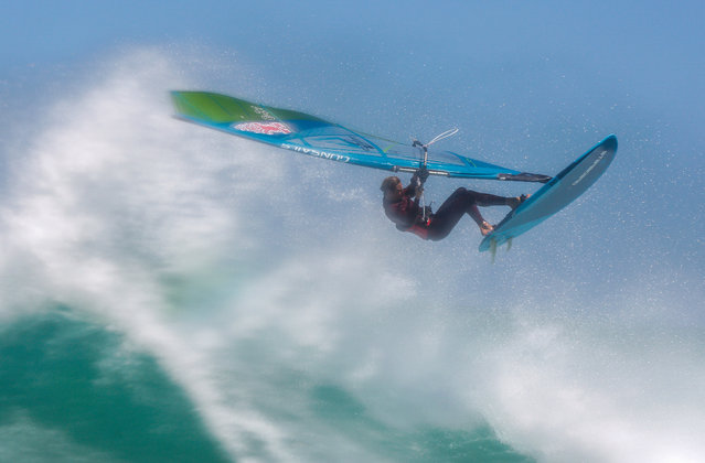 Professional windsurfer Florian Jung from Germany wavesails during a training session in Cape Town, South Africa 22 November 2018. Many top international sailors on the Professional Windsurfing Association (PWA) World Tour train in Cape Town during its summer months due to its consistantly strong winds and big waves. (Photo by Nic Bothma/EPA/EFE)