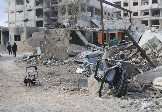 Baby strollers are seen near the debris of damaged buildings in Jobar, a suburb of Damascus, January 5, 2015. (Photo by Diaa Al-Din/Reuters)