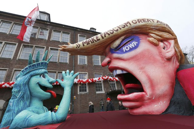 """A carnival float with a papier-mache caricature is displayed for the public at one location after the """"Rosenmontag"""" (Rose Monday) parade, the highlight of the annual carnival season, was called-off in Duesseldorf, Germany February 8, Germany 2015. Many traditional Rose Monday carnival parades were cancellend in the Rhineland due to severe weather warnings. Low-pressure system, Ruzica, bringing heavy thunderstorms and high winds is predicted for Monday, according to the weather department. (Photo by Ralph Orlowski/Reuters)"""