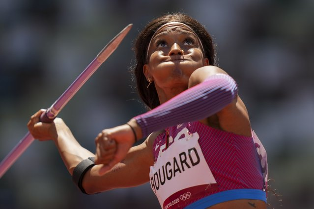 Erica Bougard, of United States, competes in the heptathlon javelin throw at the 2020 Summer Olympics, Thursday, August 5, 2021, in Tokyo. (Photo by Matthias Schrader/AP Photo)