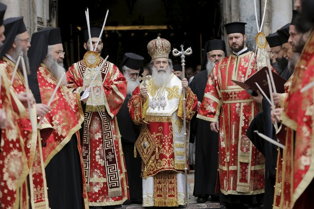 Greek Orthodox Patriarch of Jerusalem Metropolitan Theophilos (C) leaves the Church of the Holy Sepulchre to begin the washing of the feet ceremony in Jerusalem's Old City, April 9, 2015, ahead of Orthodox Easter. (Photo by Ammar Awad/Reuters)