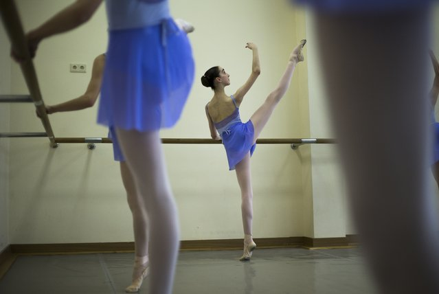 In this photo taken on Thursday March  3, 2016,  Harper Ortlieb, from Mount Hood, Oregon, performs in a ballet class at the Bolshoi Ballet Academy in Moscow, Russia. (Photo by Alexander Zemlianichenko/AP Photo)