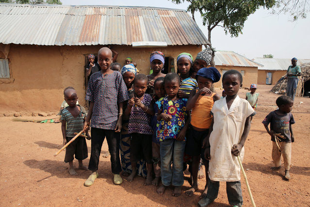 Some of the children displaced by fighting in southern Kaduna stand in front of their house in Kaduna, Nigeria  January 9, 2017. (Photo by Afolabi Sotunde/Reuters)
