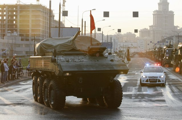 A partially covered Russian Bumerang (Boomerang) wheeled armored personnel carrier drives along a street before a rehearsal for the Victory Day parade in Moscow, Russia, April 29, 2015. (Photo by Maxim Zmeyev/Reuters)