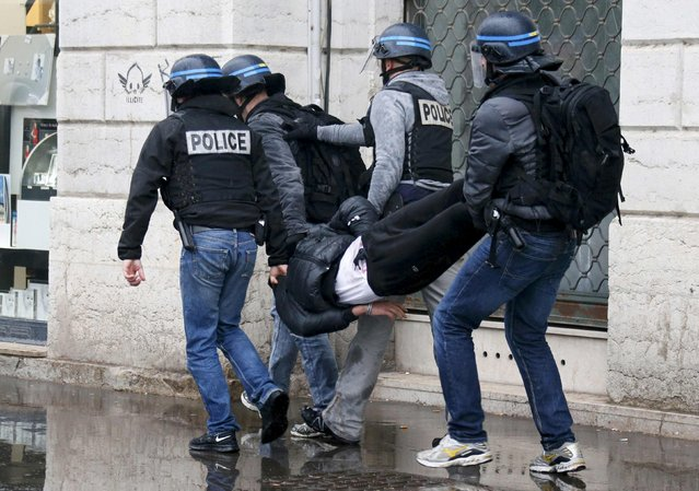 French police apprehend a man during a demonstration against the French labour law proposal in Lyon, France, as part of nationwide labor reform bill protests by students and union members, March 9, 2016. (Photo by Robert Pratta/Reuters)