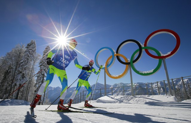 Members of the Slovenian Cross-country ski team ski in front of Olympic rings at Laura Cross-country Ski & Biathlon Center of the 2014 Winter Olympics, Sunday, Feb. 2, 2014, in Krasnaya Polyana, Russia. (Photo by Gero Breloer/AP Photo)