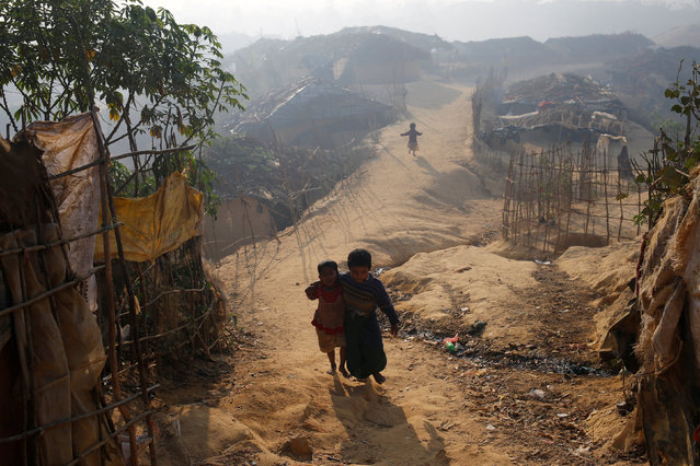 Rohingya refugee children walk in the morning at Kutupalang Unregistered Refugee Camp, in Cox's Bazar, Bangladesh, February 4, 2017. (Photo by Mohammad Ponir Hossain/Reuters)