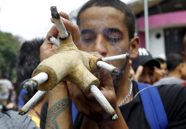 A man smokes marijuana during a demonstration in support of the legalization of marijuana in Medellin, May 2, 2015. (Photo by Fredy Builes/Reuters)