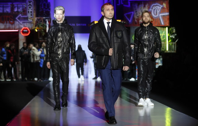 Russian actor Dmitriy Grachev (C) parodies Vladimir Putin as he presents a creation by Russian designer Ilya Shiyan during the Moscow Fashion Week Autumn/Winter 2019-2020, in Moscow, Russia, 24 March 2019. (Photo by Maxim Shipenkov/EPA/EFE)