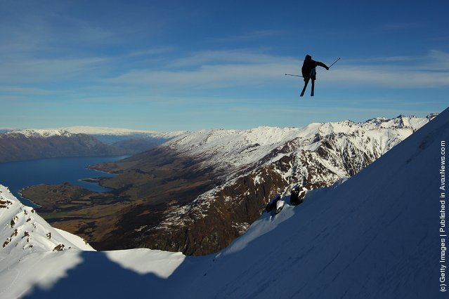 Freeskier Charlie Timmins of Australia launches off a drop during the World Heli Challenge freestyle day in backcountry at Minaret Station on July 31, 2011 in Wanaka, New Zealand
