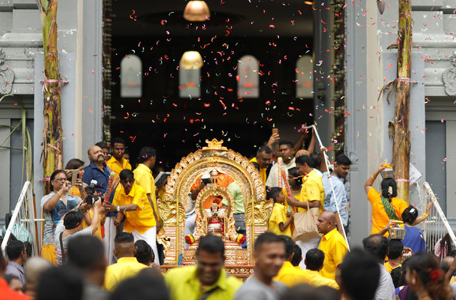 Devotees throw confetti as they reach the end of the procession during the Hindu festival of Thaipusam in Singapore February 9, 2017. (Photo by Edgar Su/Reuters)