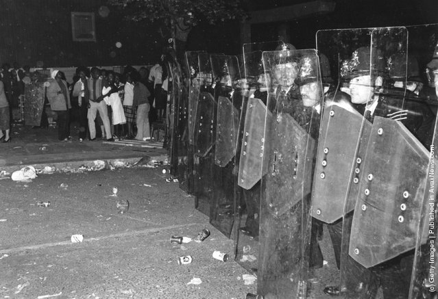 Police with riot shields during the Notting Hill Carnival, 1979