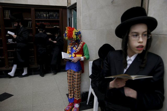 An Ultra-Orthodox Jewish boy dressed in a clown costume takes part in the reading from the Book of Esther ceremony performed on the Jewish holiday of Purim a celebration of the Jews' salvation from genocide in ancient Persia, at a synagogue in Bnei Brak March 23, 2016. (Photo by Baz Ratner/Reuters)