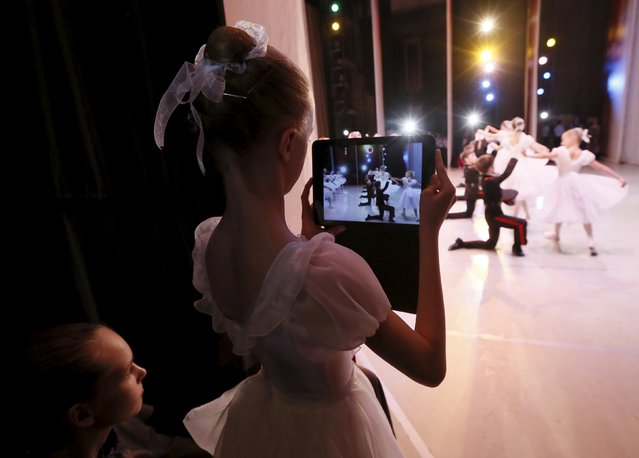 Students of the Krasnoyarsk choreographic college watch dancers during a dress rehearsal of a performance by graduates of the college at the State Theatre of Opera and Ballet in Russia's Siberian city of Krasnoyarsk, Russia, May 12, 2015. (Photo by Ilya Naymushin/Reuters)