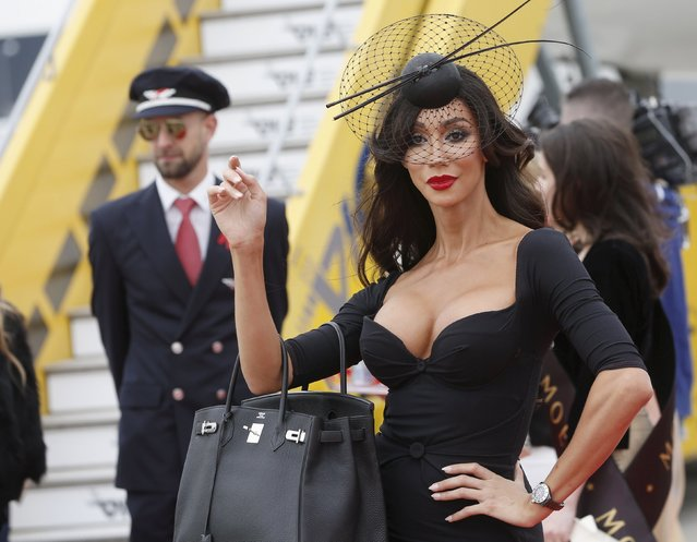 U.S. model Yasmine Petty poses upon her arrival for the Life Ball at the airport of Vienna, Austria, May 15, 2015. Life Ball is Europe's largest annual AIDS charity event and takes place at the Vienna city hall on May 16, 2015. (Photo by Leonhard Foeger/Reuters)