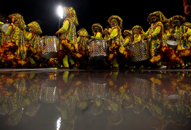 Revellers parade for the Tom Maior samba school during the carnival in Sao Paulo, Brazil, February 24, 2017. (Photo by Paulo Whitaker/Reuters)