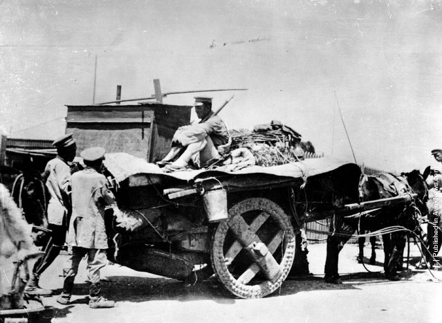 1937: The Chinese army enters Shanghai after caturing the town