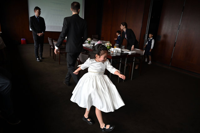 This picture taken on June 1, 2019 shows Zoey Zhang (front) attending an etiquette and manners class in central Shanghai. (Photo by Hector Retamal/AFP Photo)