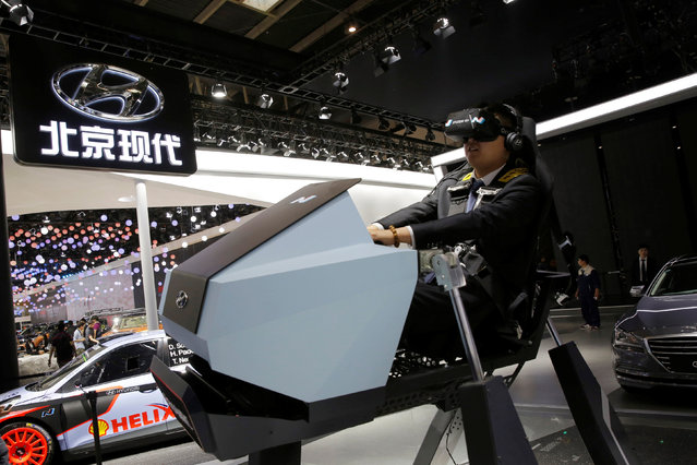 A visitor tries Hyundai's virtual reality driving machine during Auto China 2016 auto show in Beijing April 25, 2016. (Photo by Kim Kyung-Hoon/Reuters)