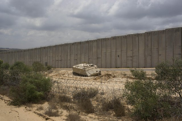 In this Thursday, June 25, 2015 photo, an Israeli APC (Armored Personnel Carrier) is parked on the Israel-Gaza border in Netiv Haasara. (Photo by Oded Balilty/AP Photo)