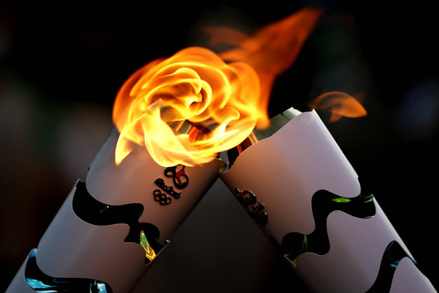 Handout picture released by the Rio 2016 Olympic Committee showing the Olympic torches in Brasilia on May 3, 2016. Embattled President Dilma Rousseff greeted the Olympic flame in Brazil on Tuesday, promising not to allow a raging political crisis, which could see her suspended within days, to spoil the Rio Games. (Photo by Fernando Soutello/AFP Photo/Rio2016)