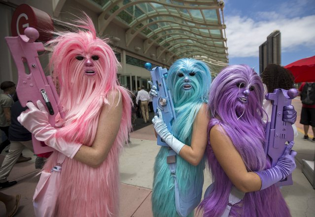"Star Wars enthusiasts wear costumes resembling what they say are three ""Chew's Angels"" during the 2015 Comic-Con International Convention in San Diego, California July 10, 2015. (Photo by Mario Anzuoni/Reuters)"
