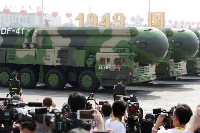 Military vehicles carrying DF-41 intercontinental ballistic missiles travel past Tiananmen Square during the military parade marking the 70th founding anniversary of People's Republic of China, on its National Day in Beijing, China on October 1, 2019. (Photo by Jason Lee/Reuters)