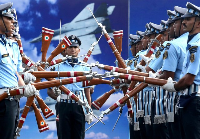 "Indian Air Force Air Warrior Drill Team perform different rifle formations in ""Drill 2 Thrill"" after the passing out parade in Bangalore, India, June 3, 2016. Around 118 officers, including 45 women, completed the 74 week training course. (Photo by Jagadeesh Nv/EPA)"