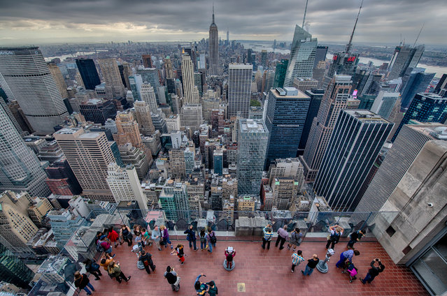 """Top of the Rock: tourists in NY. """"Shot from the top outdoor observation deck in New York City with a five shot exposure bracket. Thankfully, everyone on the deck was posing for someone or another"""". (Photo by Ed Nazarko/NatGeo Cities Travel Photographer of the Year 2017)"""