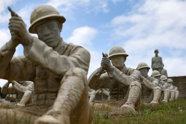 Sculptures of soldiers from the Chinese Expeditionary Force that fought against Japanese invasion during World War II (WWII) are pictured at the  Battle of Songshan mountain memorial site in Longling county of Yunnan province, China, 14 August 2015. The memorial site features 402 sculptures of soldiers of the Chinese Expeditionary Force, which helped defeat Japanese forces occupying parts of Tengchong and Longling county during the World War II. (Photo by How Hwee Young/EPA)