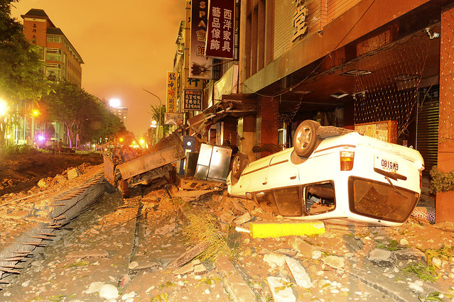 Wreckage of vehicles are seen amongst debris after an explosion in Kaohsiung, southern Taiwan, August 1, 2014. An explosion caused by a gas leak in the southern Taiwanese city Kaohsiung has killed 15 people and injured another 243, Taiwanese media reported on Friday. (Photo by Reuters/Stringer)