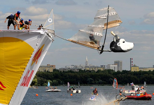 The 'Belka and Strelka' team competes during the Red Bull Flugtag event in Moscow. (Photo by Natalia Kolesnikova/AFP)